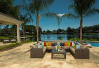 A collection of colorful accent pillows adds pizazz to the Orsay sectional covered in neutral fabric from Ebel.(Scott S Smith)