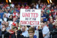 A supporter of Manchester United cheers before the UEFA Europa League final football match between Ajax Amsterdam and. Manchester United on Wednesday near Stockholm.(Agence France-Presse/Soren Andersson)
