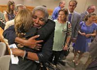 Former Judge Suzanne Wooten (with her back to camera) got a hug from Cynthia Fitzgerald Lacy after Wooten's 2011 convictions were vacated in the 416th District Court in McKinney on Wednesday.(Louis DeLuca/Staff Photographer)