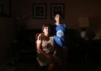 Dinorah Sierra and her son Daniel Sierra, 12, pose for a photograph at their home in Dallas. (Rose Baca/Staff Photographer)