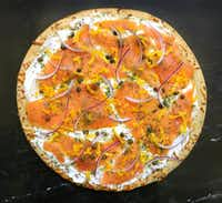 Smoked salmon and creamy goat cheese pizza(Louis DeLuca/Staff Photographer)