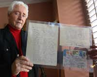 Ron Jones poses with a letter from <i>Doctor Zhivago</i> author Boris Pasternak he received as a young man. (Louis DeLuca/Staff Photographer)