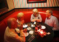 Vaughn Gross (second from left) shares a laugh with Tex Gross, Paige Flink and Randy Flink during dinner at Campisi's Egyptian Restaurant in Dallas. The Flinks have been in Dallas for 40 years and are dining out  a couple times a week at places that are as old as their time in Dallas. (Vernon Bryant/Staff Photographer)