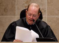 District Judge Mark Rusch reads the charge to the jurors during the trial of Enrique Arochi last year.(David Woo/Staff Photographer)