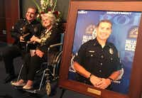 Det. Edmundo Lujan poses with his mother-in-law, Raquel Hinojos, at a ceremony at the Dallas Police Department on Thursday.(Naheed Rajwani)