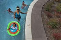 Swimmers on Friday enjoyed a trip on the lazy river at JadeWaters at the Hilton Anatole Hotel in Dallas.(Louis DeLuca/Staff Photographer)