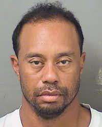"""A booking photo <span style=""""background-color: transparent; font-size: 0.6875rem;"""">of Tiger Woods, who was taken into custody early Monday.</span>(Palm Beach County Sheriff's Office)"""