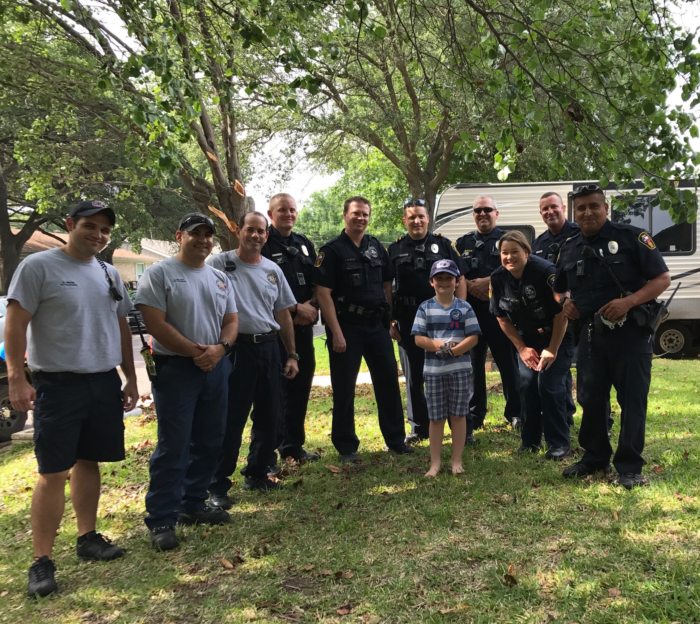 <p>Graham is surrounded by Hurst police officers and firefighters who celebrated his birthday with him.&amp;nbsp;</p>(Facebook)