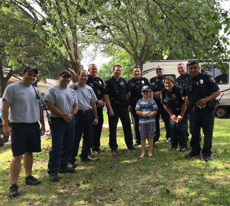 <p>Graham is surrounded by Hurst police officers and firefighters who celebrated his birthday with him.&nbsp;</p>(Facebook)