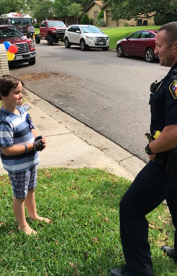 """<p><p><span style=""""font-size: 1em; background-color: transparent;"""">Graham Day, 8, talks with a Hurst police officer who celebrated his birthday with him.</span></p></p>(Facebook)"""