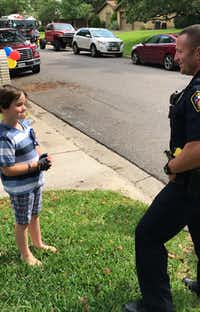"<p></p><p><span style=""font-size: 1em; background-color: transparent;"">Graham Day, 8, talks with a Hurst police officer who celebrated his birthday with him.</span></p><p></p>(Facebook)"