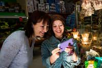 Jamileh Jafari (right) shops with Olga Pope of the Sunday Supper Series at Shahrzad Mediterranean Market in Richardson. (Smiley N. Pool/Staff Photographer)