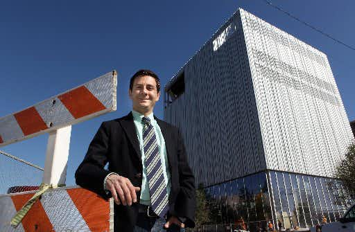 Dallas Theater Center artistic director Kevin Moriarty stands in front of the new Dee and Charles Wyly Theatre Center. (2009 File Photo/David Woo)
