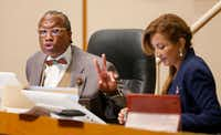 Dallas County Commissioner John Wiley Price speaks next to District 4 Commissioner Elba Garcia during a Commissioners Court meeting in May.(Jae S. Lee/Staff Photographer)
