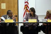 Dallas County Commissioner John Wiley Price speaks with Juvenile Department Director Terry Smith and Judge Cheryl Lee Shannon during a Dallas County Juvenile Board meeting in 2014.(Ben Torres/Special Contributor)