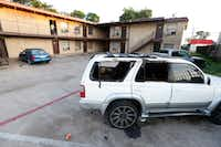 Someone set fire to this Toyota 4Runner, which sits parked in the lot at 3006 Holmes St. in South Dallas.(Ron Baselice/Staff Photographer)