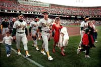 """<p>Oakland A's players leave the field with their families<span style=""""font-size: 1em; background-color: transparent;"""">at San Francisco's Candlestick Park</span><span style=""""font-size: 1em; background-color: transparent;"""">after an earthquake struck the region during the World Series.</span></p>(1989 File Photo/AP)"""