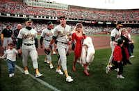 """<p>Oakland A's players leave the field with their families&nbsp;<span style=""""font-size: 1em; background-color: transparent;"""">at San Francisco's Candlestick Park&nbsp;</span><span style=""""font-size: 1em; background-color: transparent;"""">after an earthquake struck the region during the World Series.&nbsp;</span></p>(1989 File Photo/AP)"""