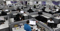 Workers at Teladoc's Lewisville call center. (David Woo/The Dallas Morning News)