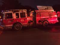 A Dallas firefighter was injured when an engine rolled on its side in central Oak Cliff.(KXAS-TV (NBC5)/Maria Guerrero)