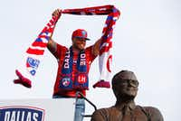 Dallas Cowboys quarterback Dak Prescott performs the scarfing ceremony before the MLS soccer game between FC Dallas and Real Salt Lake at the Toyota Stadium in Frisco, Texas on June 3, 2017. At every home stand, a special guest adorns the statue of Lamar Hunt with an FC Dallas scarf.(Tailyr Irvine/Staff Photographer)
