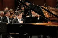 "<p><span style=""font-size: 1em; background-color: transparent;"">Pianist Yutong Sun performs with conductor Nicholas McGegan and the Fort Worth Symphony Orchestra in the semifinal round of the Van Cliburn International Piano Competition on Sunday at Bass Performance Hall in Fort Worth.</span></p>(<br>/Ralph Lauer<div>Van Cliburn Foundation</div>)"