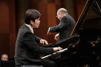 Pianist Hongii Kim performs with conductor Nicholas McGegan and the Fort Worth Symphony Orchestra in the semifinal round of the Van Cliburn International Piano Competition on Sunday at Bass Performance Hall, Fort Worth. (Ralph Lauer/Van Cliburn Foundation)