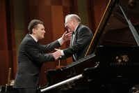 Pianist Yury Favorin and conductor Nicolas McGegan after a performance with the Fort Worth Symphony Orchestra in the semifinal round of the Van Cliburn International Piano Competition on Sunday at Bass Performance Hall in  Fort Worth. (Ralph Lauer/Van Cliburn Foundation)
