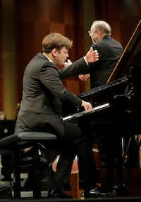 Pianist Georgy Tchaidze with conductor Nicholas McGegan and the Fort Worth Symphony Orchestra in the semifinal round of the Van Cliburn International Piano Competition on Sunday at Bass Performance Hall, Fort Worth. (Ralph Lauer/Van Cliburn Foundation)