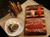 A charcuterie board at Knife Dallas. The nduja is the dark-red football-shaped spreadable meat.(Nathan Hunsinger/Staff Photographer)