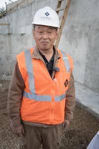 Suminori Awata is a Japanese stone mason working on the project.(Harwood International)