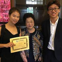 From left: Subin Cho, flute teacher Monica Song and Yeongjae Jo.