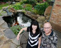 Kimberly and Ed Atchley have a pond in the back yard of their Richardson home.(Ron Baselice/Staff Photographer)