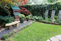 Kimberly Atchley's backyard garden in Richardson includes a chicken coop.(Ron Baselice/Staff Photographer)