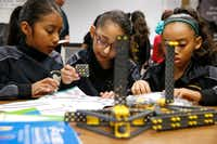 Leah Ybarra, 9, Ibri Cotonieto, 9, and Alexi Greenwood work on next years robot project during robotics club at Winnetka Elementary in Dallas on May 26, 2017.(Nathan Hunsinger/Staff Photographer)