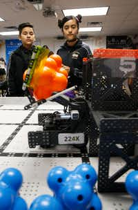 Abelino Graciano, 11, (left) and Keyri Fernandez, 11, use Wildbot to move around modules for points during  robotics club at Winnetka Elementary in Dallas on May 26, 2017.(Nathan Hunsinger/Staff Photographer)