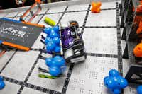 Wildbot manipulates modules during robotics club at Winnetka Elementary in Dallas on May 26, 2017. (Nathan Hunsinger/Staff Photographer)