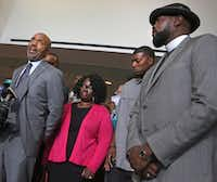 Attorney Daryl Washington talks with the media as Jordan Edwards' stepmother Charmaine Edwards and father Odell Edwards listen at a May 11 press conference. At right is Pastor Michael Waters. (Louis DeLuca/Staff Photographer)