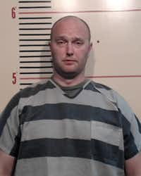 Roy Oliver, fired Balch Springs police officer, is shown in a Parker County Jail booking photo after he turned himself in on a charge of murder Friday May 5.(Parker County Sheriff's Dept.)