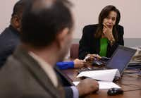 In this 2015 file photo, Terry Smith, executive director Dallas County Juvenile Department, listens to John Pita, deputy director of clinical services/chief psychologist, during a meeting at the Henry Wade Juvenile Justice Center in Dallas.(Rose Baca/Staff Photographer)