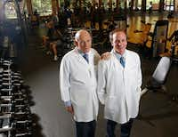 Dr. Kenneth Cooper and his son Dr. Tyler Cooper posed for a portrait at Cooper Aerobics Center in Dallas in May.  (Nathan Hunsinger/Staff Photographer)