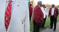 Kappa Alpha Psi 50-year member Stephen Washington displays his necktie as members gather at their chapter's house in South Dallas.(Louis DeLuca/Staff Photographer)