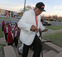 Kappa Alpha Psi 50-year member Stephen Washington climbs the stairs to get to the chapter's house in South Dallas. (Louis DeLuca/Staff Photographer)