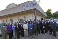 Fraternity brothers of Omega Psi Phi gather for a group photo at chapter headquarters in Dallas. (Louis DeLuca/Staff Photographer)