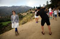 Author Merritt Tierce poses for a portrait next to tourists taking pictures near the Hollywood sign. (Patrick T. Fallon/Special Contributor )