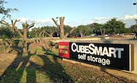 "CubeSmart says it had nothing to do with the tree ""pruning."" OK, but what about this says ""pruning""?(Robert Wilonsky/Staff)"