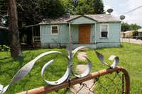 Vacant HMK properties located on McBroom Street in Dallas on Wednesday.(David Woo/Staff Photographer)