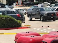 Police say a woman was trapped under an SUV Thursday morning in the Kroger parking lot in Cedar Hill.(Margo Garfias Castillo)