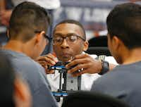 West Point Cadet Lt. James Grays helps Mauricio Pantoja, 12, left, and Christian Orozco, 15, build a VEX robot at a DISD STEM camp at Henry W. Longfellow Career Exploration Academy in Dallas.(Nathan Hunsinger/Staff Photographer)