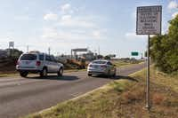 A warning sign about texting while driving is seen near northbound Interstate 35 and Lakeview Boulevard in Denton.(Jeff Woo/Denton Record-Chronicle)